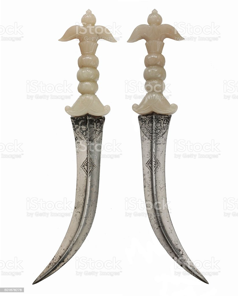 Asian daggers steel curved blade ivory handle crossed for decora stock photo