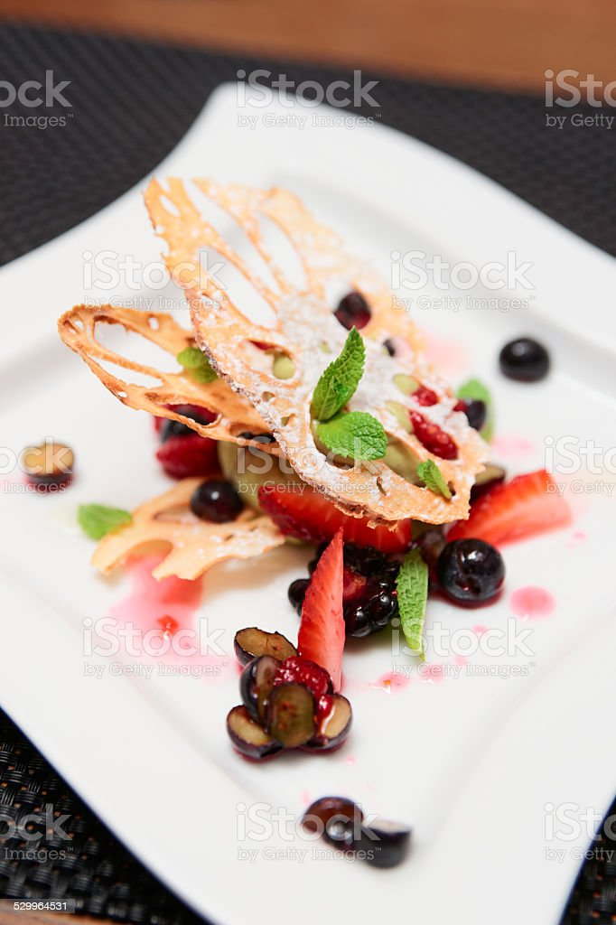 Asian dessert with lotus root and berries stock photo