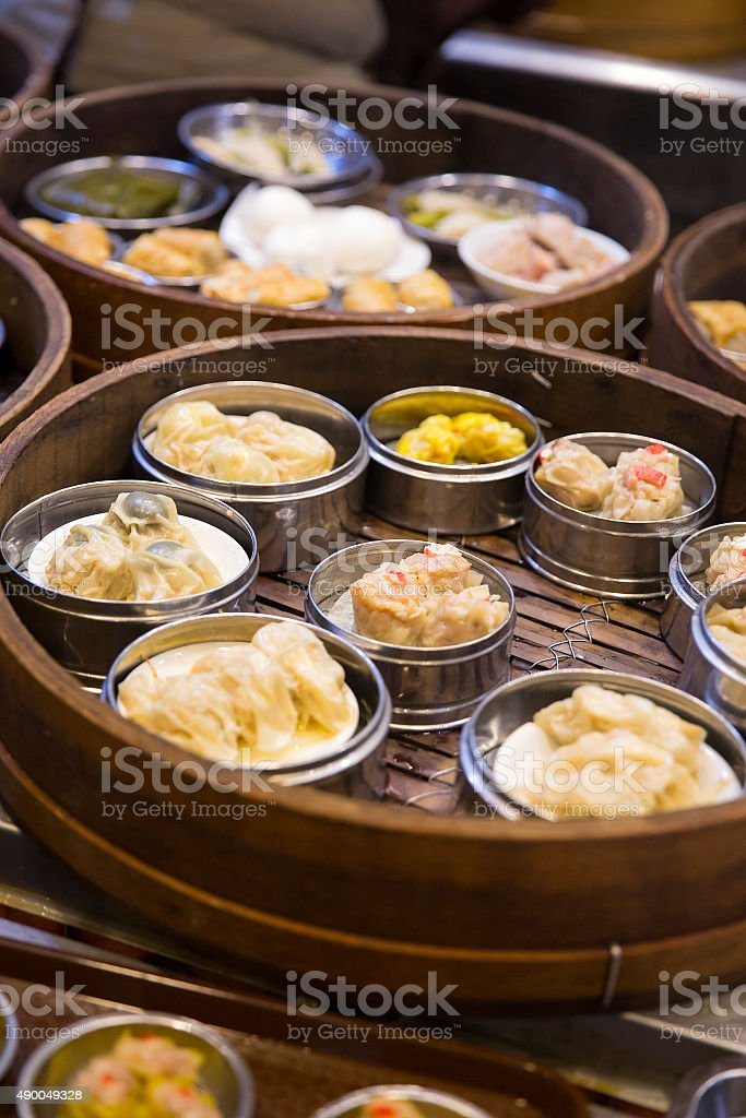 Asian dim sum in bamboo steamer stock photo