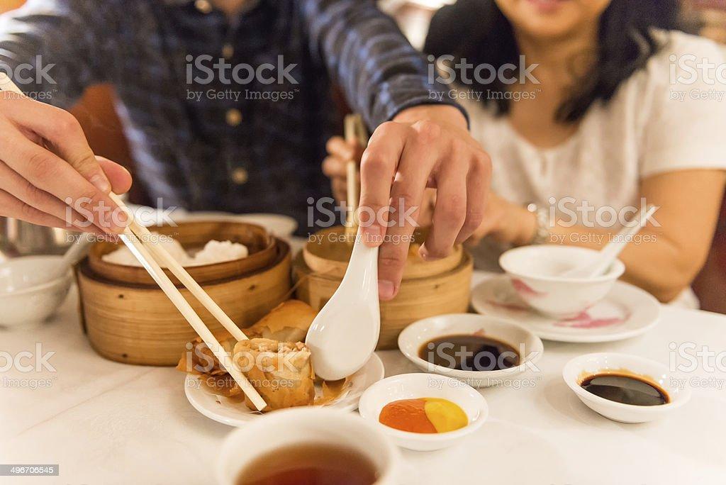Asian Diners Enjoying Dim Sum stock photo