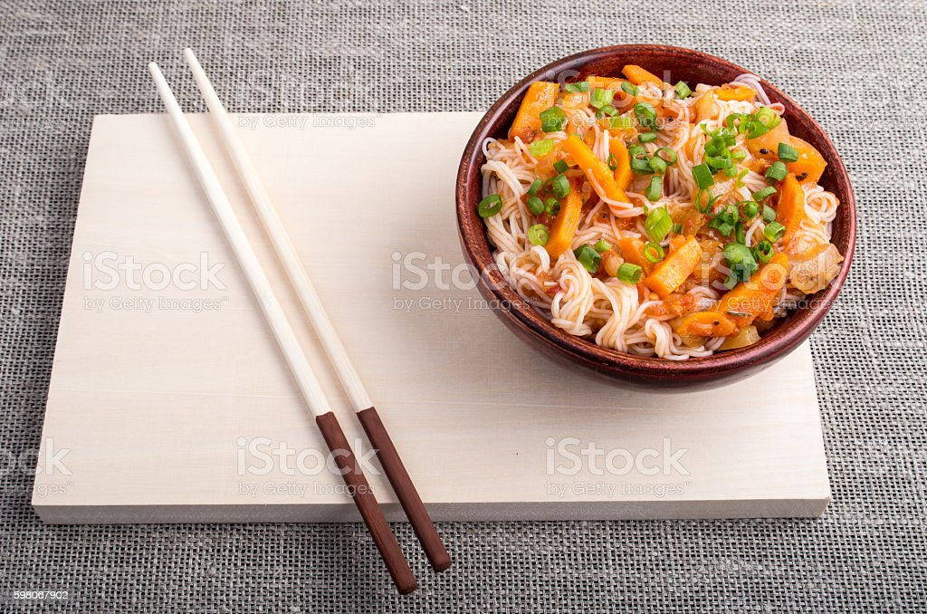 Asian dish of rice noodle in a small wooden bowl stock photo