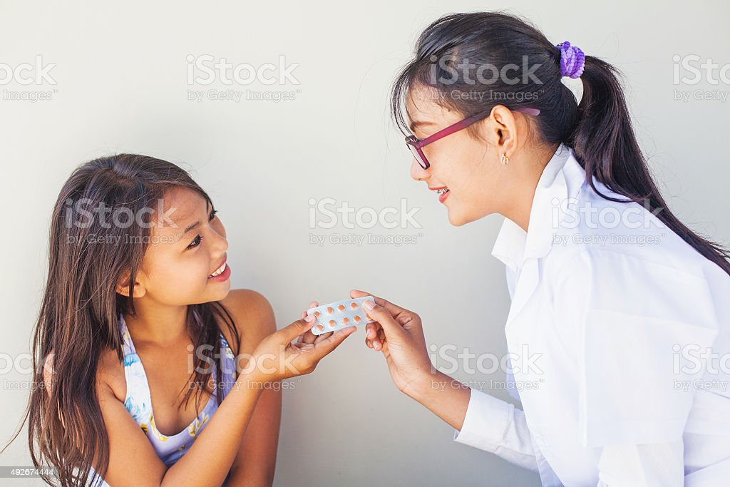 Asian doctor and little patient stock photo