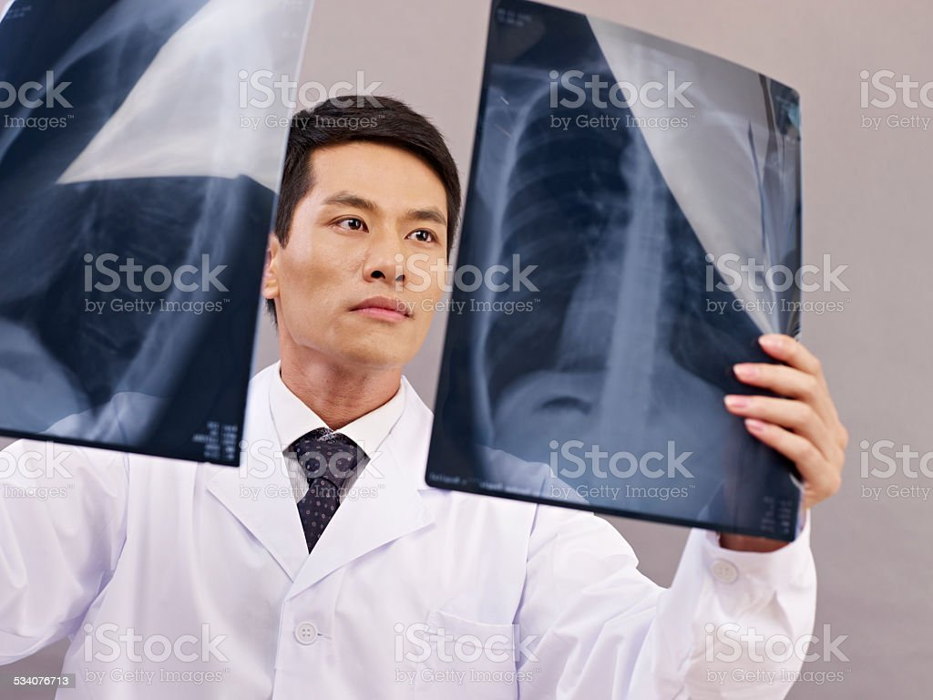 asian doctor at work stock photo