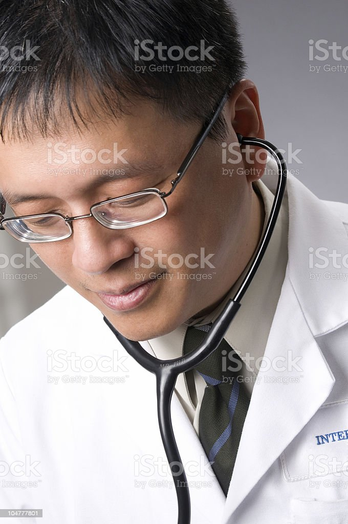 Asian Doctor Looking at X-ray royalty-free stock photo
