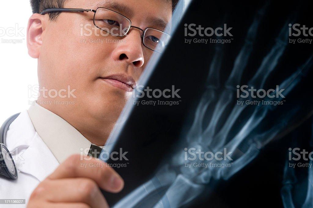 Asian Doctor Reading  X-Ray royalty-free stock photo