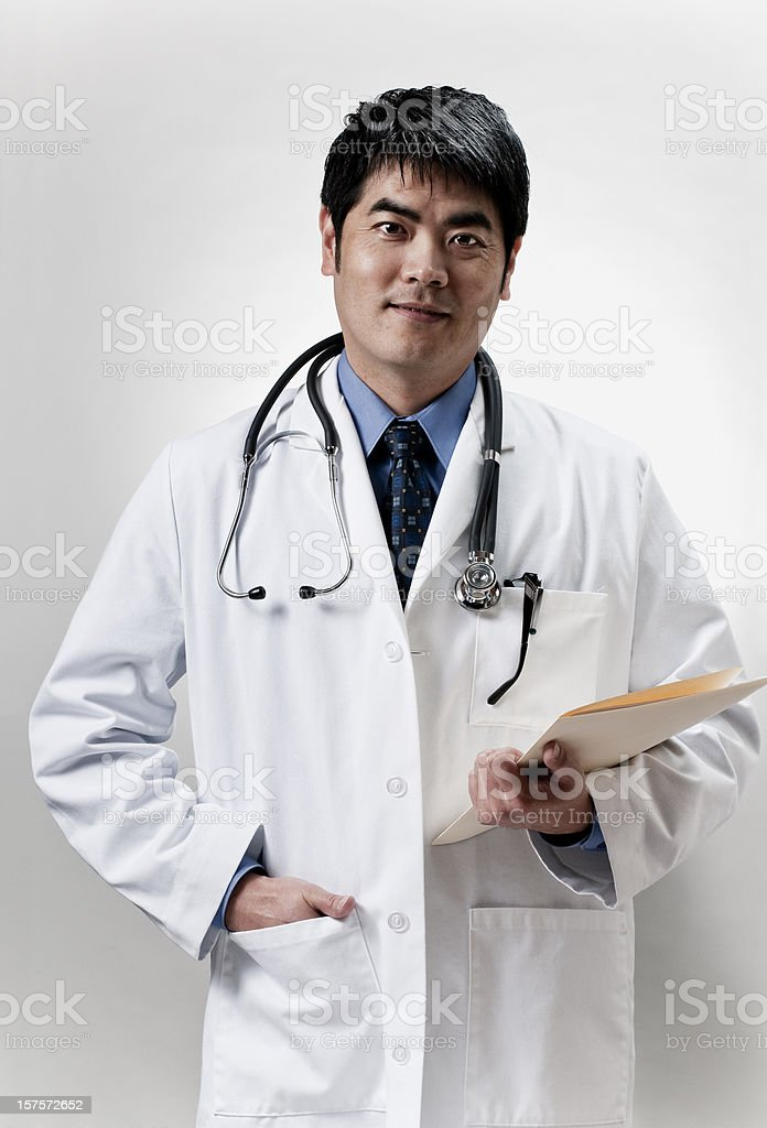 Asian doctor with folder royalty-free stock photo
