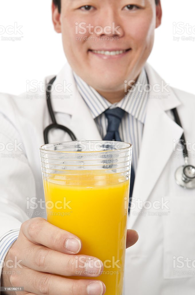 Asian Doctor With Orange Juice royalty-free stock photo
