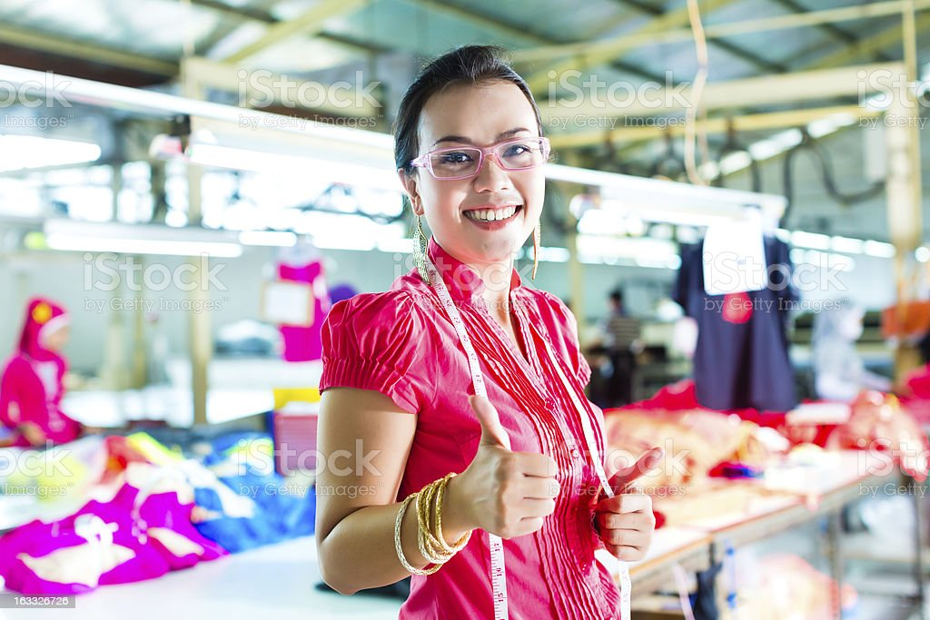 Asian dressmaker in a textile factory stock photo