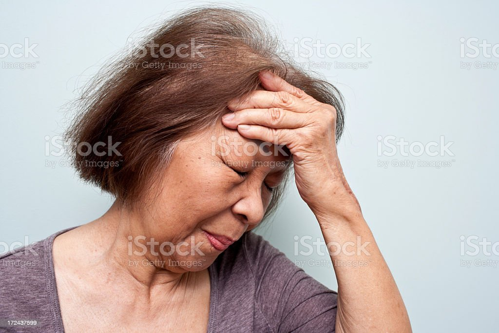 Asian Elderly woman with a headache royalty-free stock photo