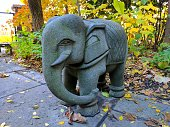 Asian Elephant Stone Sculpture in Fall