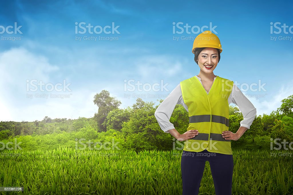 Asian engineer wearing safety vest stock photo