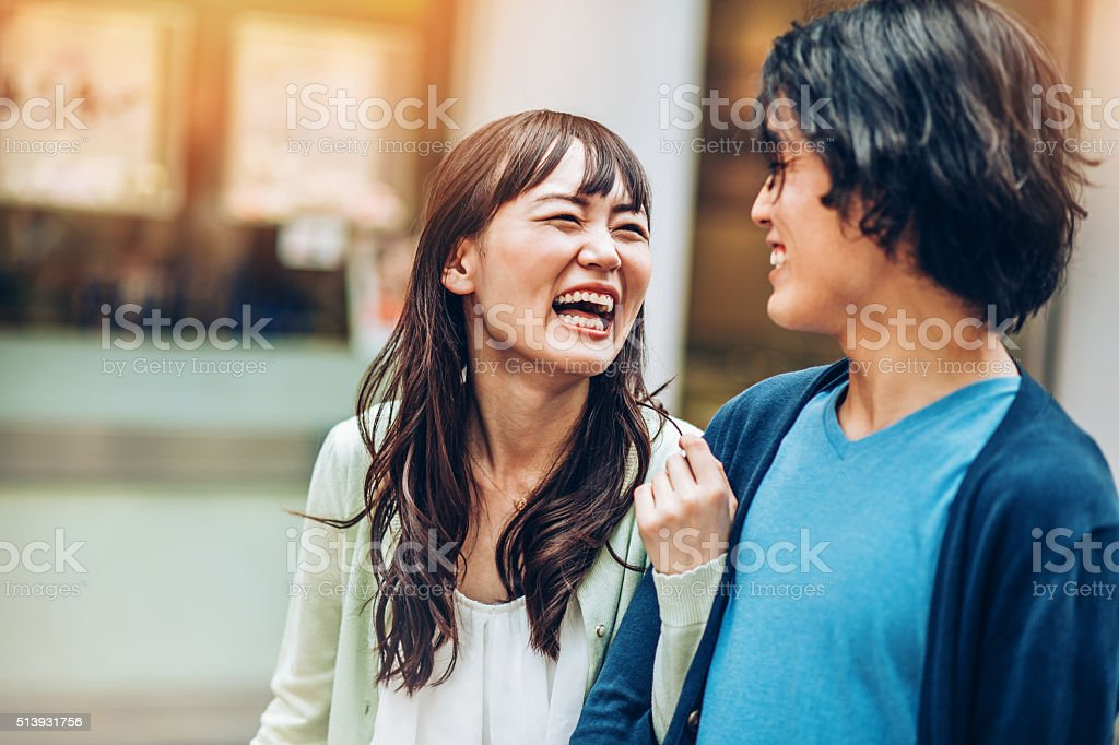 Asian ethnicity couple laughing stock photo