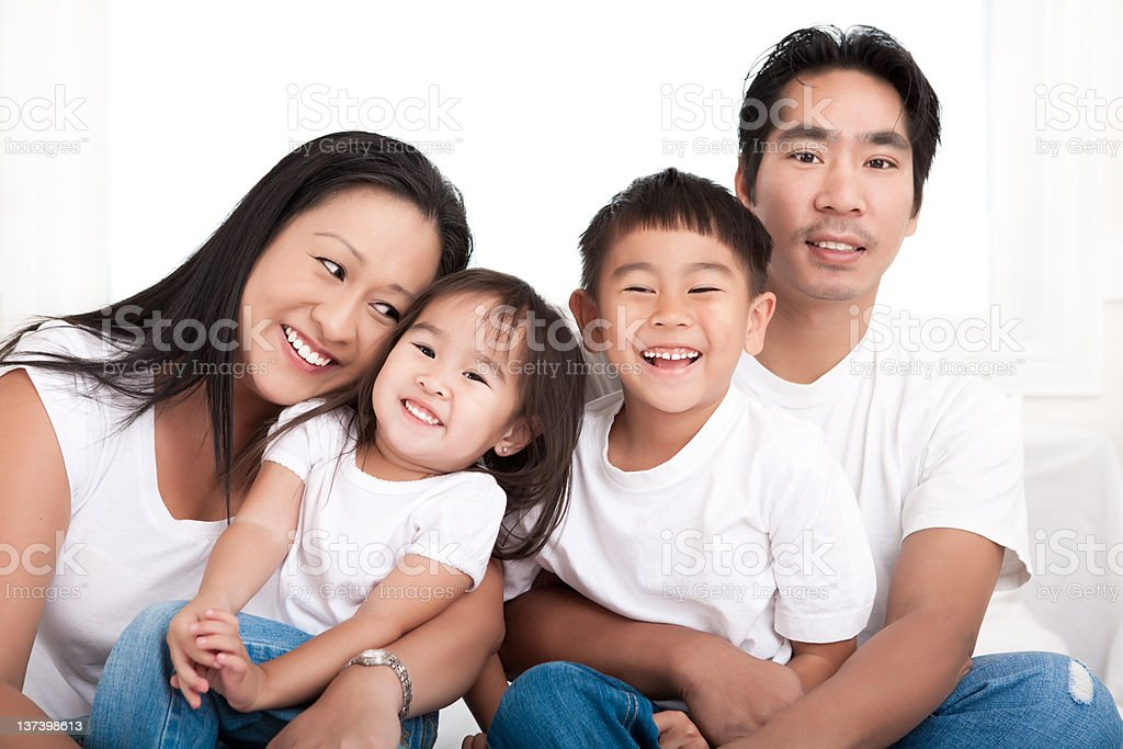 Asian family bedroom portrait royalty-free stock photo