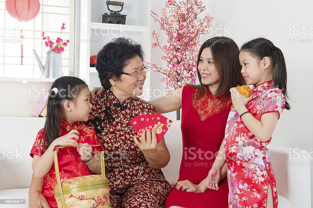 Asian family celebrate Chinese new year at home. stock photo
