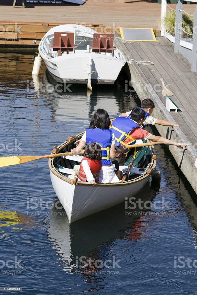 asian family docks canoe royalty-free stock photo