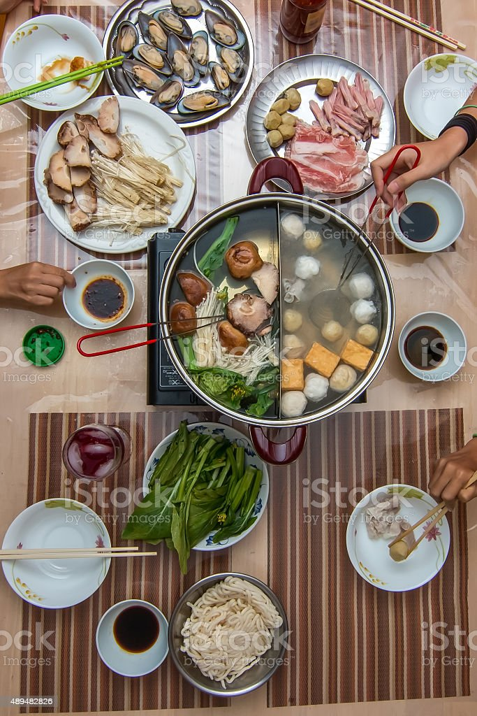 Asian family eating hot pot stock photo