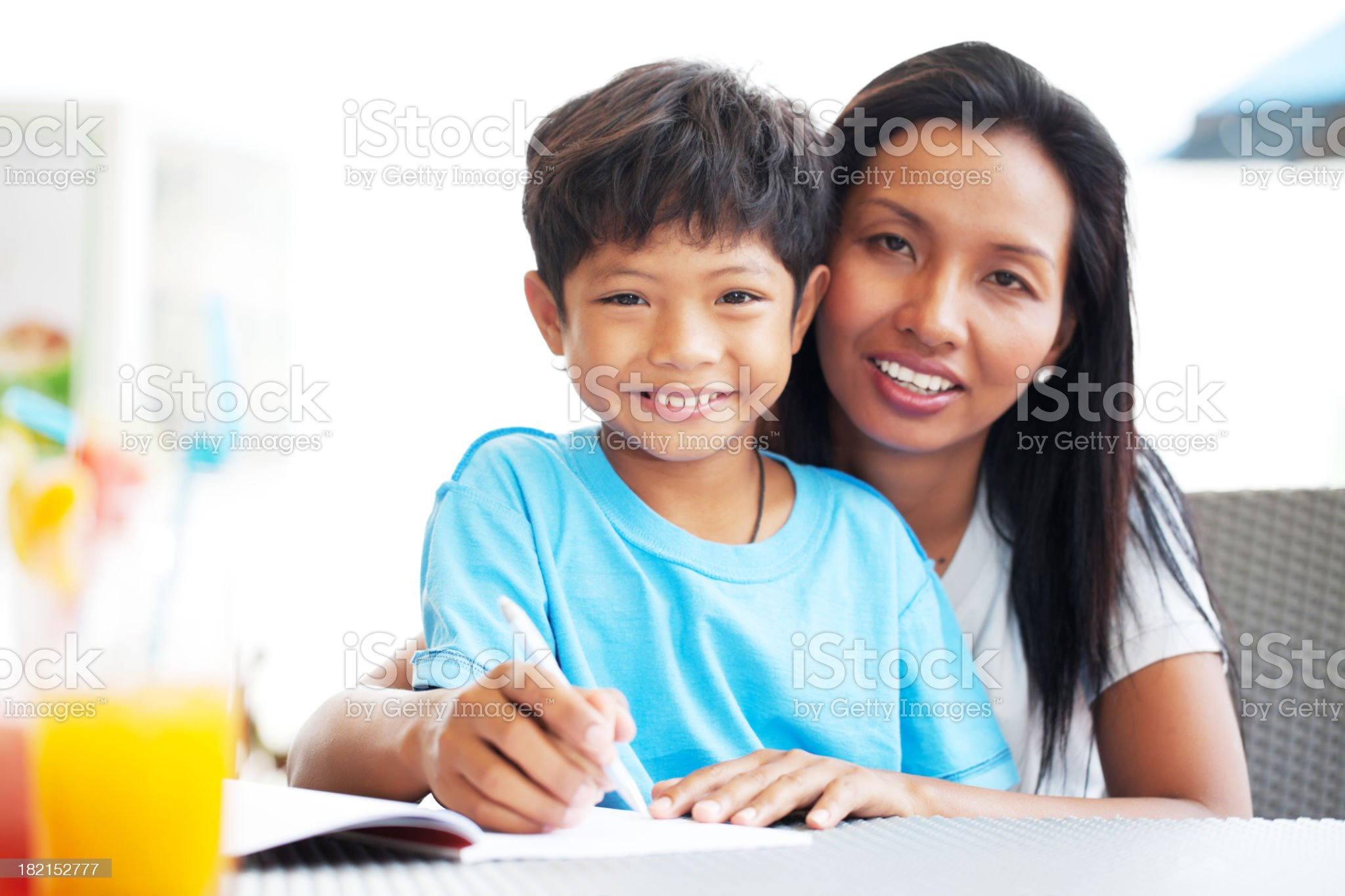 Asian family enjoys in a cafe. royalty-free stock photo