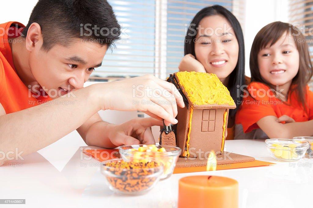 Asian family halloween cake decorating royalty-free stock photo