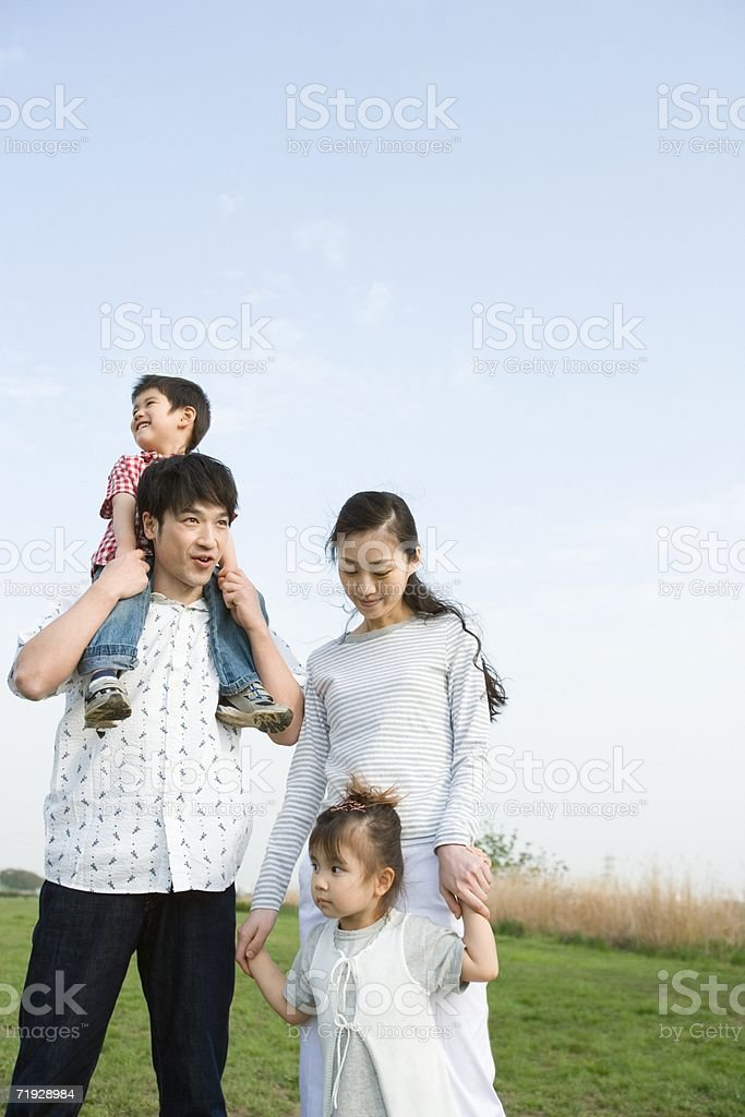 Asian family in a field royalty-free stock photo