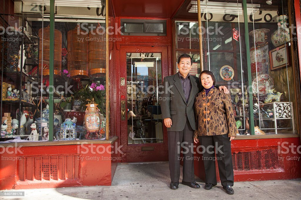Asian family in front of store stock photo