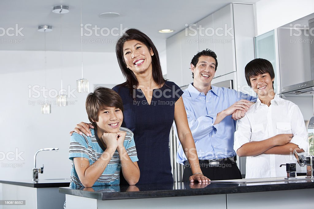 Asian family in kitchen royalty-free stock photo