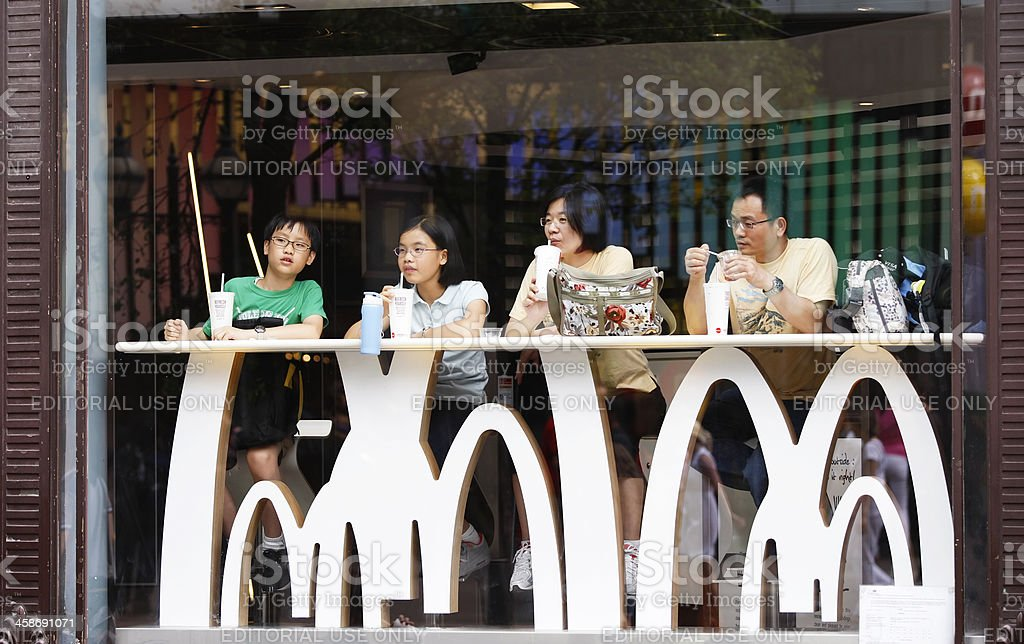 Asian family in McDonald's royalty-free stock photo