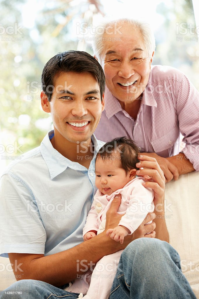 Asian family of father, his son and granddaughter royalty-free stock photo