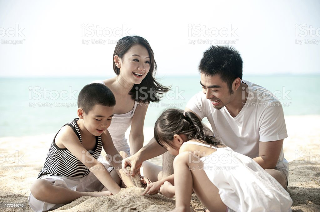 Asian family on the beach royalty-free stock photo