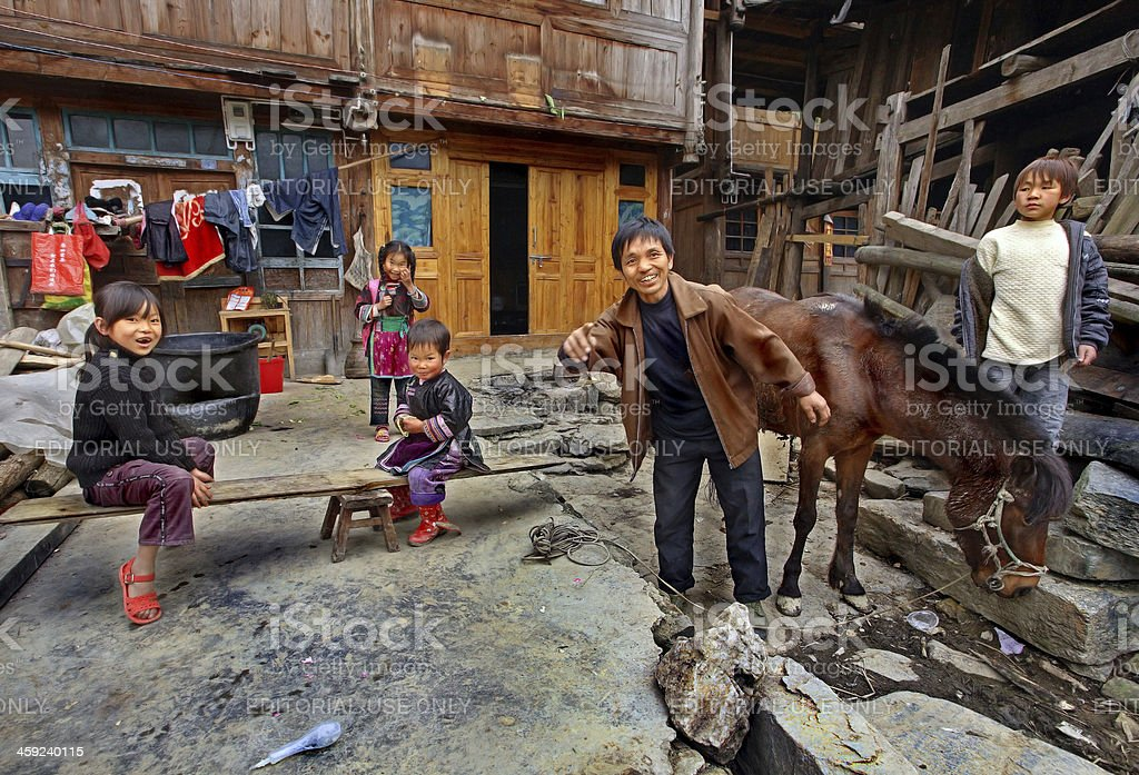Asian family peasant farmers in rural areas of southwestern China. stock photo