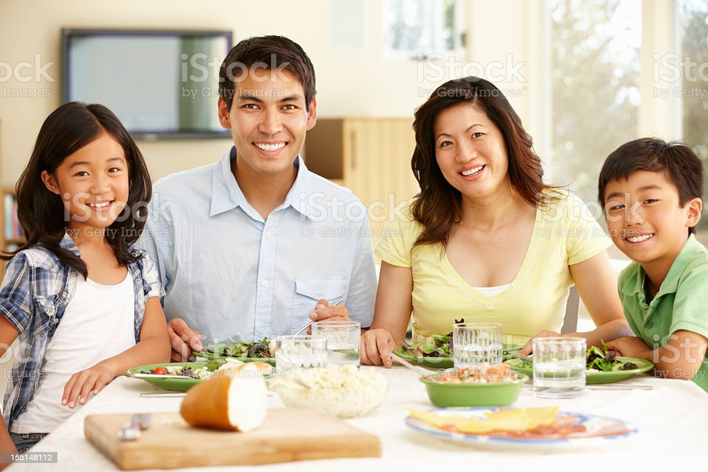 Asian family sharing meal at home royalty-free stock photo