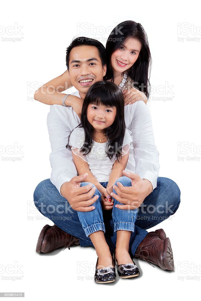 Asian family sit in the studio stock photo