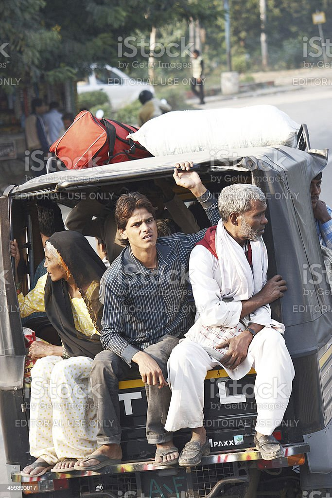 Asian family travelling in back of auto rickshaw royalty-free stock photo