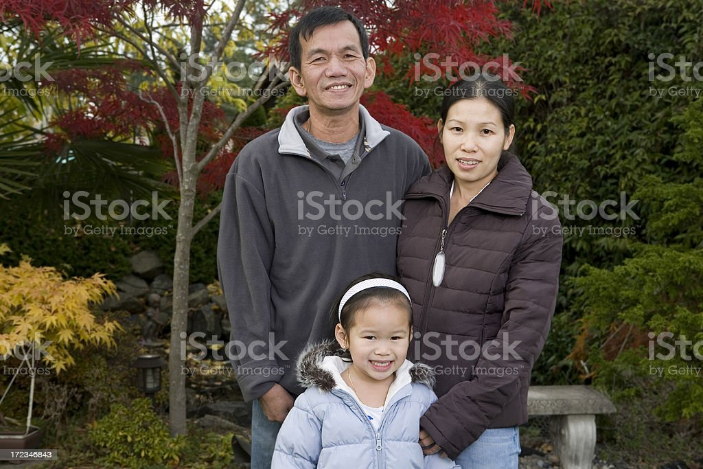 Asian Family with Little Girl Posing for Outdoor Portrait, Copyspace royalty-free stock photo