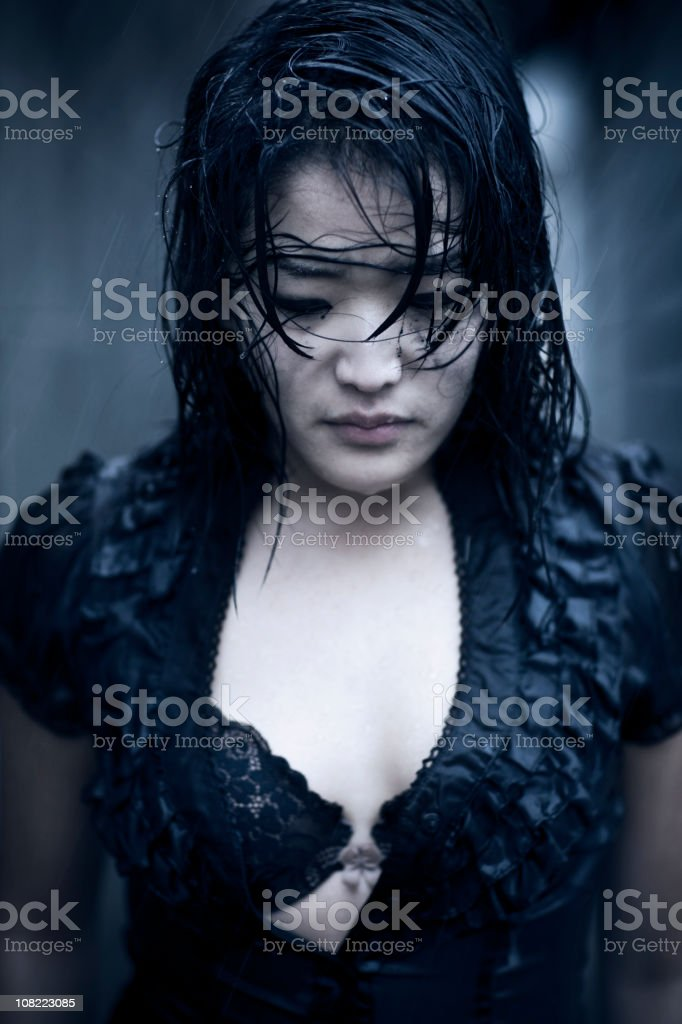 Asian Young Woman Crying and Wet from Rain, Portrait royalty-free stock photo