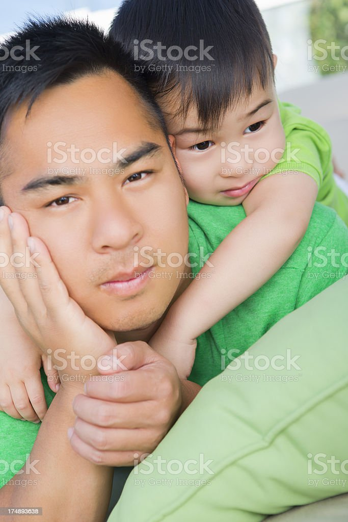 Asian father and son outdoor portrait royalty-free stock photo