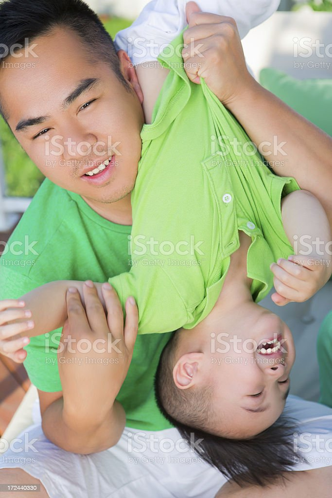 Asian father bonding with son royalty-free stock photo