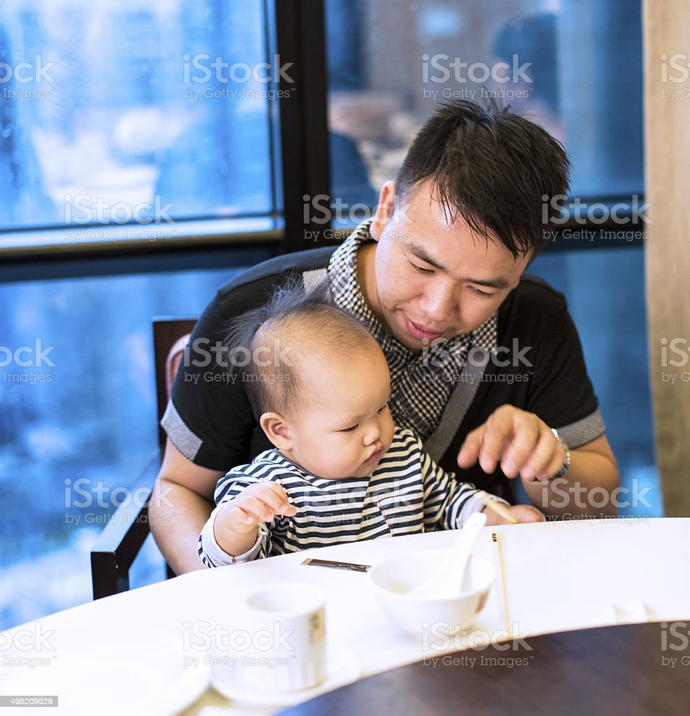 asian father with baby royalty-free stock photo