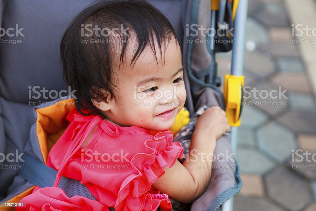 Asian female baby smile in perambulator royalty-free stock photo