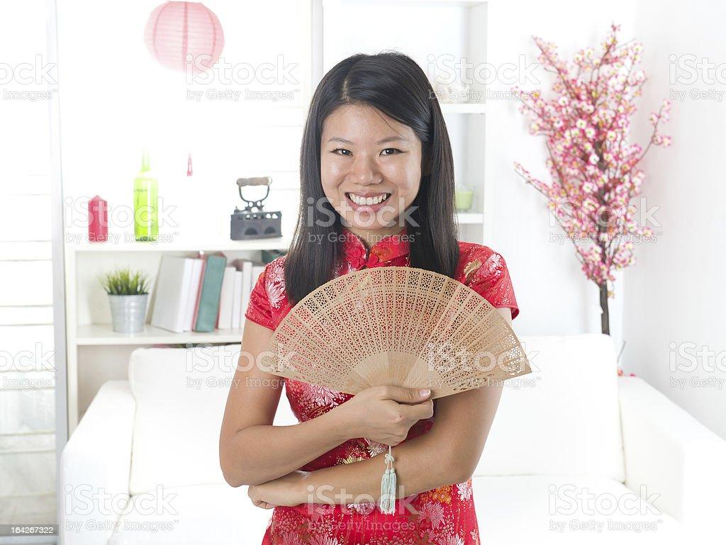 asian female celebrating chinese new year royalty-free stock photo