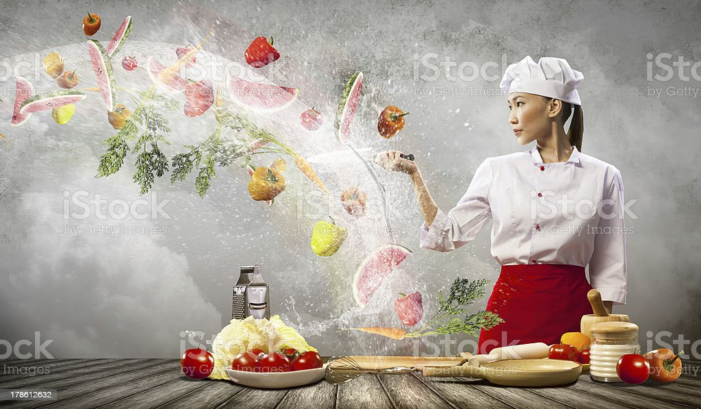 Asian female cook with knife stock photo