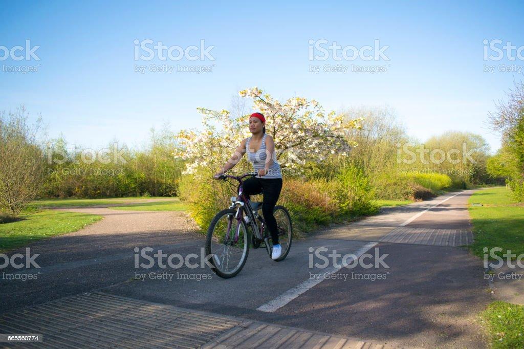 Asian Female Cycling stock photo