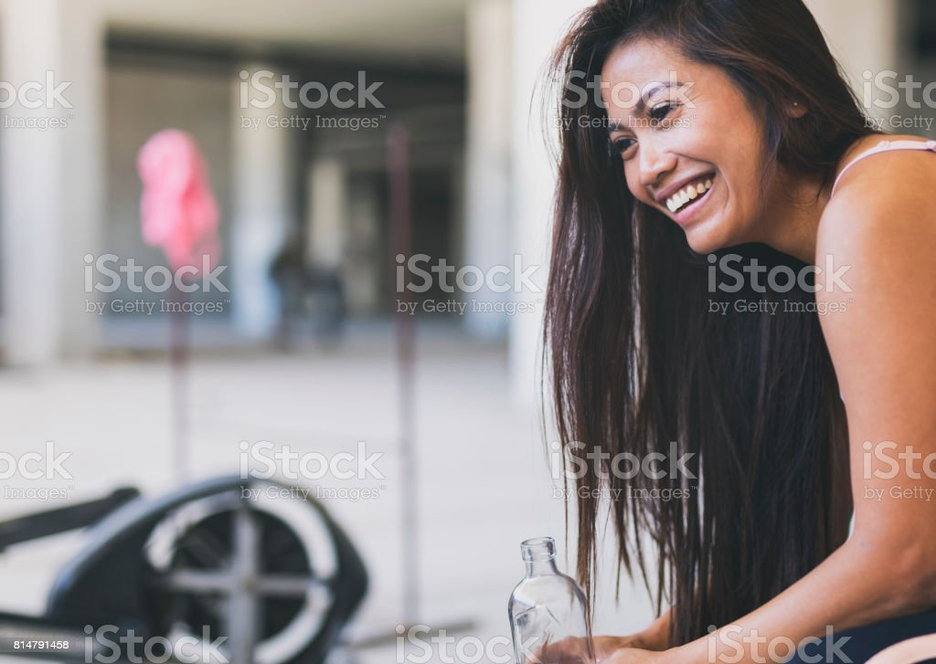 Asian female in an urban gym stock photo