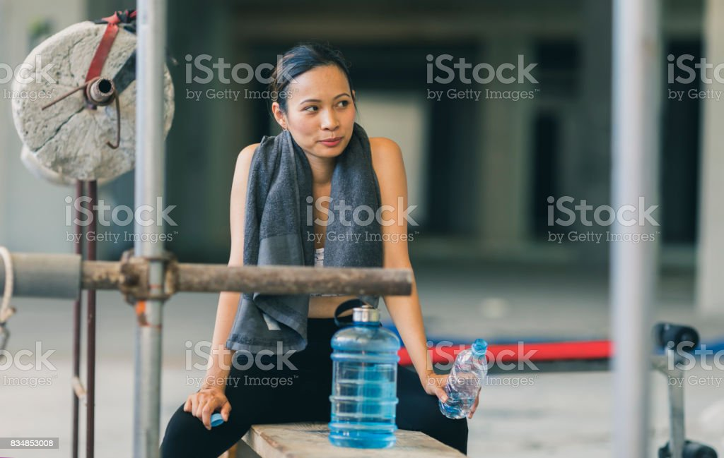 Asian female in an urban gym stock photo
