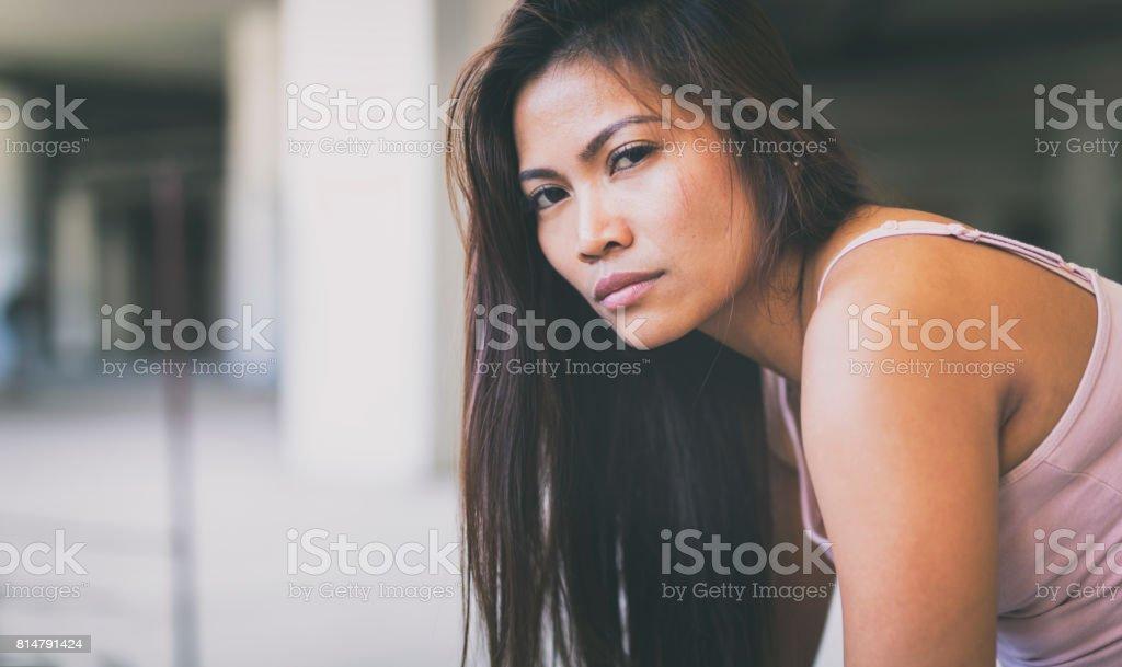 Asian female in an urban setting stock photo