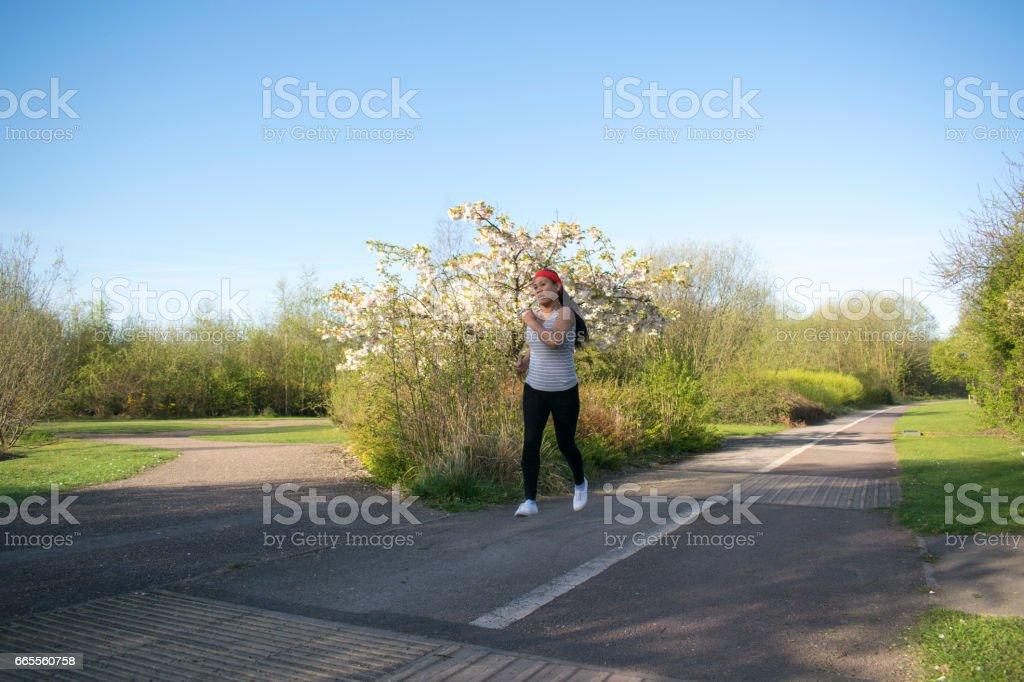 Asian Female Jogging stock photo