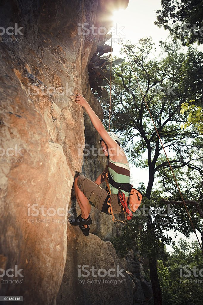 Asian Female Rock Climber Scaling Wall royalty-free stock photo