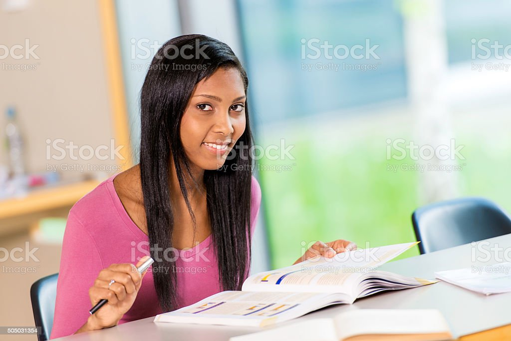 Asian female student in library stock photo