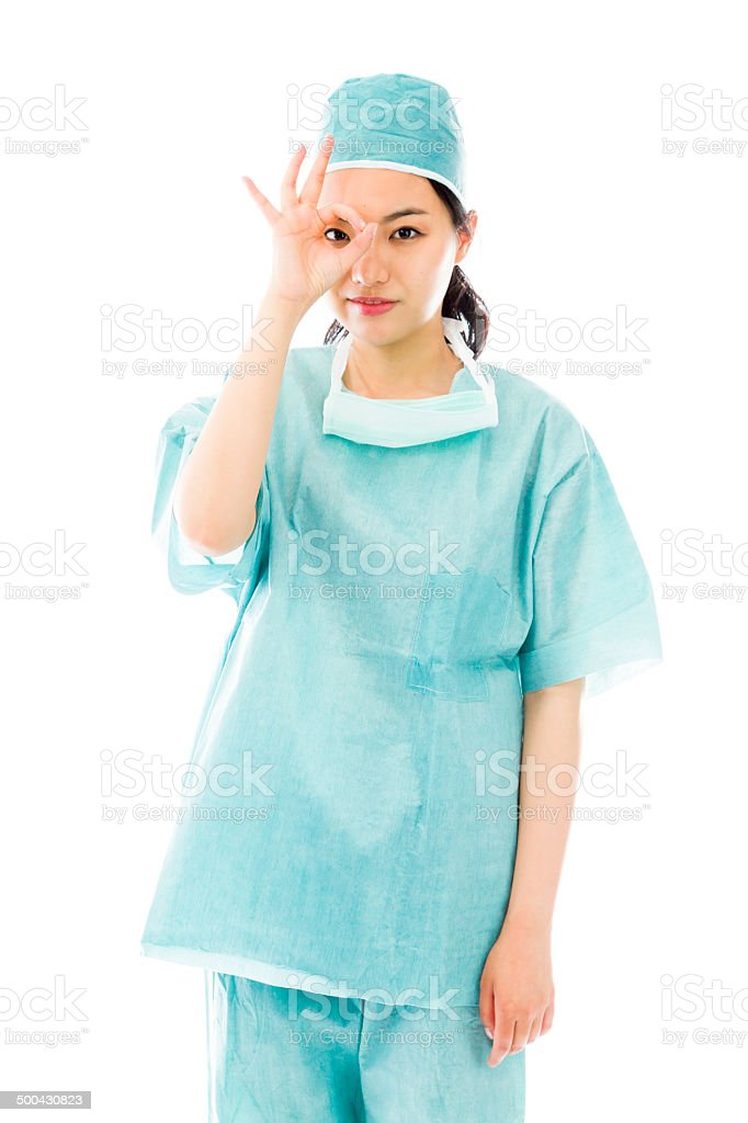 Asian female surgeon showing ok sign stock photo