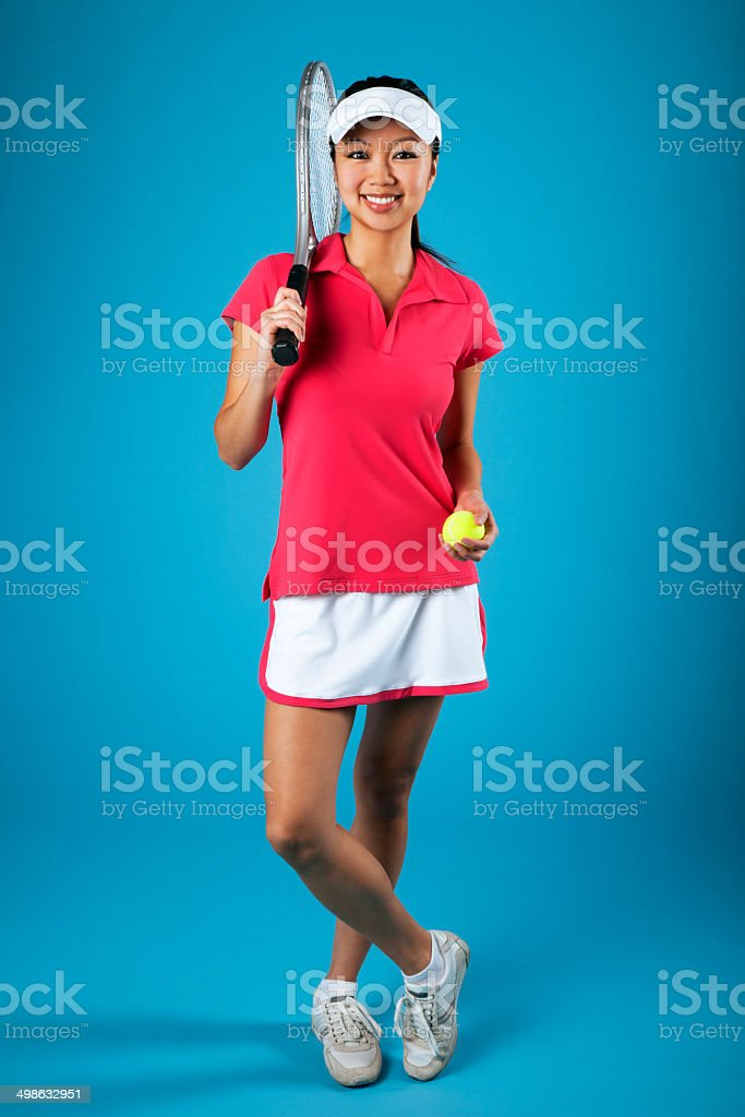 Asian Female Tennis Player on Blue Background royalty-free stock photo