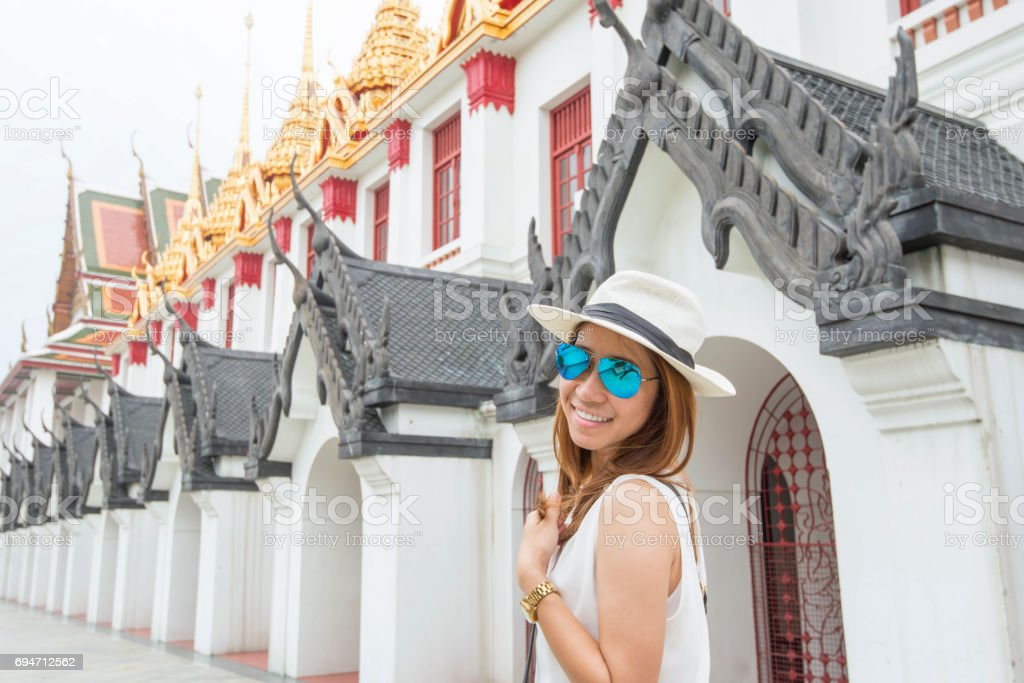 Asian female tourist visiting a temple in Bangkok, Thailand stock photo
